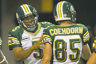 Edmonton Eskimos quarterback Kerry Joseph (left) is all smiles celebrating a first-half TD with Nate Coehoorn Monday in Edmonton.
