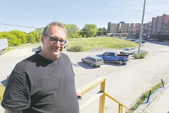 Riverbend Movers owner Wayne Kitchur was told repeatedly by the city the Mulvey Avenue East property was not for sale.