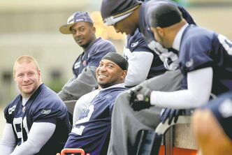 Blue Bombers players appear to be enjoying themselves during a break from practice at Canad Inns Stadium on Tuesday.