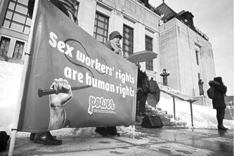 Chris Mikula / The Ottawa Citizen Archives Sex trade workers and their supporters gather on the front steps of the Supreme Court of Canada building in Ottawa as they challenge Canada's criminal laws regarding adult prostitution.