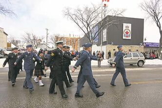 Top: Armed Forces members march during a  Remembrance Day parade from Royal Canadian Legion No. 7 in Transcona to Blessed Sacrament Church on Roanoke Street.