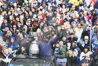 chris young / the canadian pressToronto Argonauts� Jordan Younger holds the Grey Cup during the victory parade in downtown Toronto Tuesday.