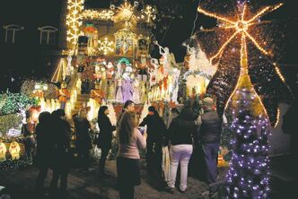 Spectators admire an elaborately decorated home belonging to Lucy Spata in the Brooklyn borough of New York.
