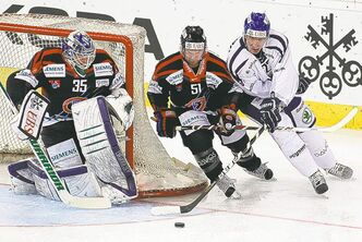 Vancouver Canucks goalie Cory Schneider stands guard for Fribourg in Friday's Spengler Cup game against Vitkovice Steel.