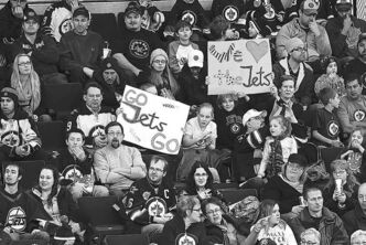 Fans take in the first Jets practice of the shortened season on Sunday.