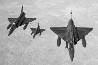 French Mirage warplanes on their way to a bombing mission to stop Islamist fighters from taking over Mali.