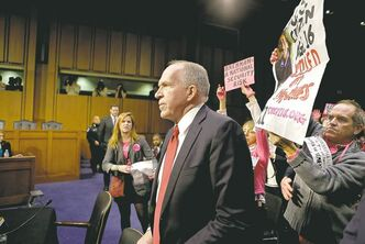 Protesters from CODEPINK, a group opposed to U.S. militarism, disrupt the start of the U.S. Senate intelligence committee confirmation hearing for John Brennan, U.S. President Barack Obama�s nominee for CIA director.