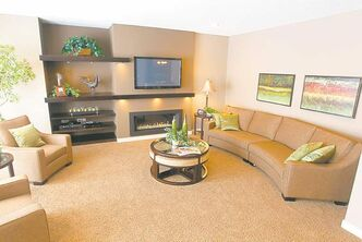 Family room offers a five-tiered maple entertainment unit and ribbon-style gas fireplace.
