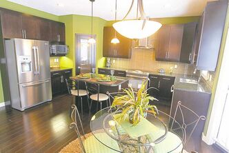 The kitchen island is big enough to offer food-preparation space plus an eating nook for two.