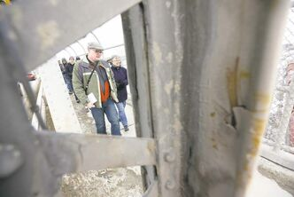 TREVOR HAGAN / WINNIPEG FREE PRESS  Blogger and Winnipeg history buff Christian Cassidy leads a tour of the Arlington Street Bridge Sunday. The span's long, storied history could end within 10 years.