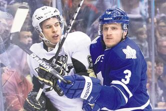 Pittsburgh captain Sidney Crosby (left) tussles with Toronto's Dion Phaneuf in Saturday night NHL action in Toronto.