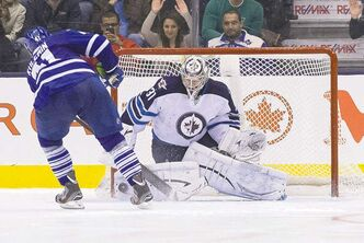 Denied  Jets goaltender Ondrej Pavelec stymies Leafs' Nikolai Kulemin in the shootout Saturday night in Toronto.