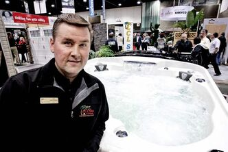 Jay Breckman, general manager of LCL Spas, with one of the many hot-tubs on display last weekend at the Home Expressions show at the Winnipeg Convention Centre.