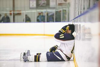 The agony of defeat: A hat trick wasn't enough for Thrashers captain Alex Keena.