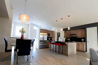 Island kitchen and dining area at 7 Water Lily Lane.