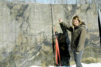 Jaime Pineau of Granite Mountain Stone Design with an example of Black Fantasy solid granite.