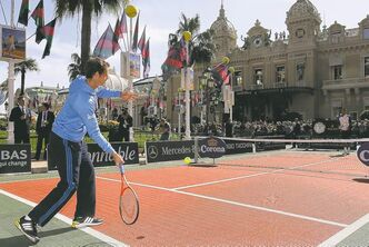Andy Murray plays a shot to Novak Djokovic in an exhibition match Saturday in front of the Casino of Monte-Carlo ahead of this week's Monte Carlo Masters tournament.