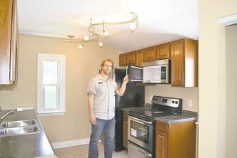 Rob Robson of RentalRatRace.ca in new kitchen. Below: Before photo