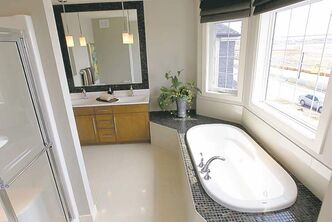 The jetted soaker tub in the master bedroom ensuite is surrounded by a big bay window.