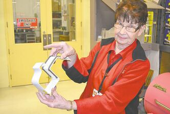 Betty Kabaluk of Home Hardware with a two-part snap-lock joiner for vinyl gutters.