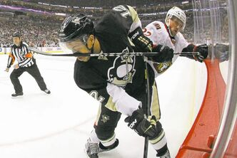 Gene J. Puskar / The Associated PressPittsburgh Penguins� Jarome Iginla gets a stick in the face courtesy Ottawa Senators� Erik Condra in the second period of Game 2 in Pittsburgh on Friday night.