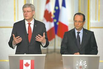 Stephen Harper and French President Francois Hollande in Paris Friday.