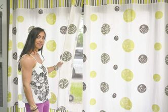 Lindsay Buus with an in-house designed drape created for the company's showroom.