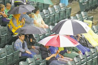 Goldeyes fans wait patiently for Thursday's American Association game between Winnipeg and the Lincoln Saltdogs to start at Shaw Park. Instead, after being rained out, the teams will play a double-header beginning at 6 p.m. today.