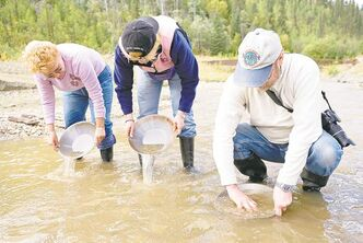 Visitors panning for gold at the Gold Bottom Mine.