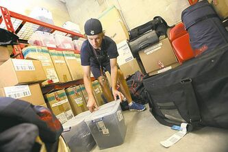 Samson makes sure team equipment is neatly packed  and stored in the clubhouse.