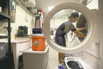 Industrial washing machines in the clubhouse keep uniforms and towels fresh.