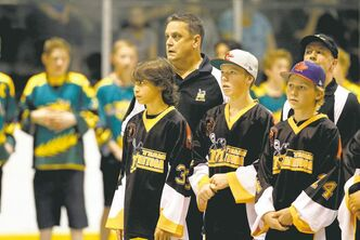 Team Manitoba (right) joins Team Saskatchewan at Billy Mosienko Arena in the opening ceremonies Friday.