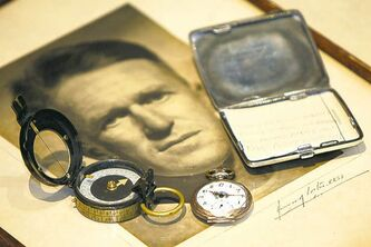 A photo of T.E. Lawrence and his compass, watch and cigarette case