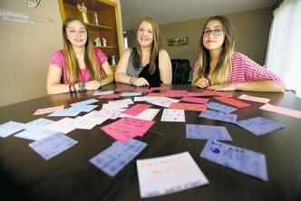 Mikayla Carter, Marley St. Cyr and Mackenzie Carter responded to other people's negative actions by leaving about 200 inspirational notes around downtown and The Forks on Sunday.