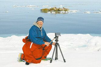 Taylor photographing walruses in the Arctic