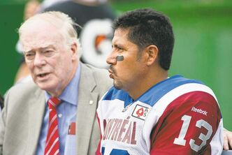 Dr. David S. Mulder talks to quarterback Anthony Calvillo after Calvillo took a hit during the first half against the Saskatchewan Roughriders in Regina on Saturday.