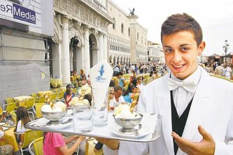 Waiter Marco Amice arrives with post-gondola ride gelatos at Al Todaro restaurant's patio on busy St. Mark's Square.