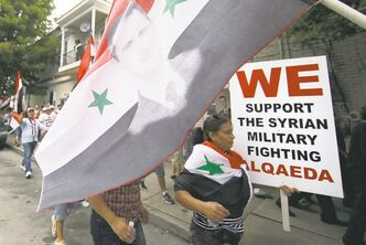 Members of the Allentown, Pa., Syrian community march Friday against expected U.S. military action in Syria.