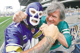 Winnipeg fan Shayne Montpetit (left) and Saskatchewan fan Don Gerlach face off before the Bomber-Saskatchewan game Sunday.