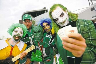 Scott Landrie, Rory Stewart, Mike Quinn, Darrin Klassen and Derreck Wegner show their green before watching the Saskatchewan Roughriders visit the Winnipeg Blue Bombers during the Banjo Bowl Sunday.