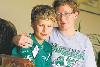 Roughrider fan Hugh Montgomery, 8, and mom, Jodi, are angry at the way a Bombers fan treated them last Sunday.