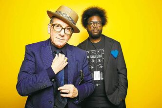From left, English singer-songwriter Elvis Costello poses for a portrait with drummer Ahmir �Questlove� Thompson of The Roots, in promotion of their upcoming album Wise Up Ghost, on Tuesday, May 21, 2013, in New York. (Dan Hallman/Invision/The Associated Press)