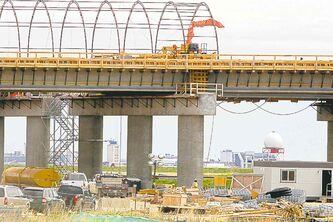A rail overpass goes up off Inkster Boulevard earlier this year.