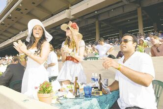 Racegoers at the Del Mar Racetrack normally sport dresses, blazers and skirts. And ladies, don't forget your hat.