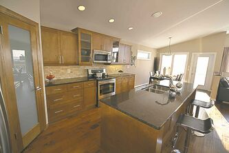 The kitchen/dinette, is spacious, functional, well-finished  and bright.