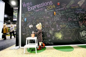 A giant blackboard at the Home Expressions Show at the convention centre.  Emily Neufeld, 3, draws on a giant blackboard at the Home Expression Show at the convention centre Saturday. Now that spring is here, fixing up our homes is top of mind. The show continues today.