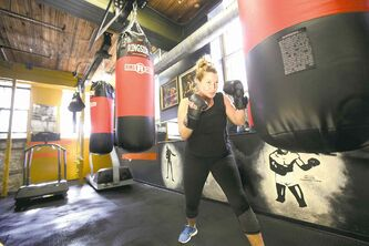 Tracy Tjaden trains on the bag at the Pan Am Boxing Club. She graduated from the high-intensive, six-week Fight Club, a program that pushed her beyond her limits.