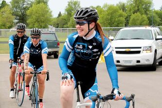 Clara Hughes leaves Brandon University with her riding team on Day 92 of Clara's Big Ride.