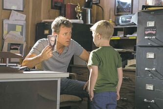 Greg Kinnear, left, and Connor Corum