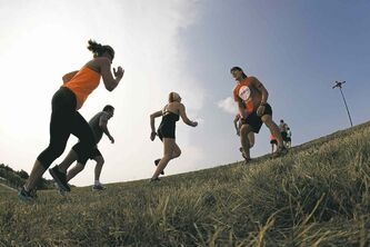 Adventure racer Johnny Fukumoto leads a fitness session. Hill-running training is key to the rigors of obstacle races.